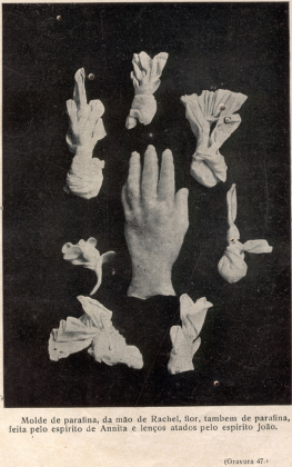 materialized objects in plaster having been captured in paraffin wax moulds: a hand, flower, and sitters handkerchiefsf said to have been knotted by João
