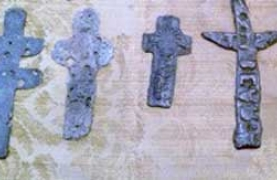 Photograph of examples of the 1500 Aztec Indian crosses found buried in remote locations