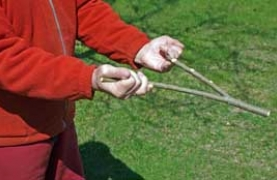 photograph of hands holding dowsing rods